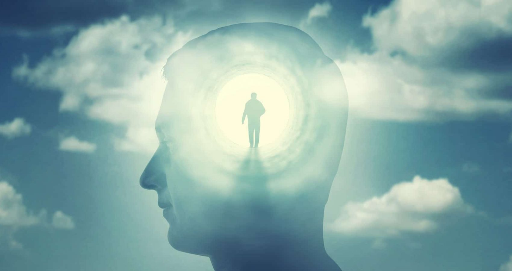 A silhouete of a man with rays of light emanating from the brain as a symbol of the power of thinking. Concept on the topic of psychiatry (bipolar disorder, schizophrenia), psychology, religion, science, spiritual growth.